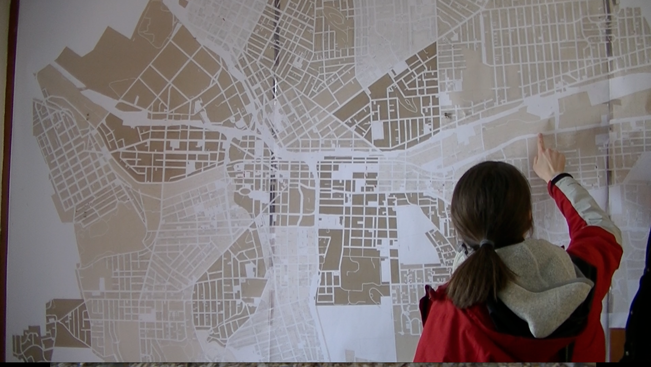 Urban Ecology | Brenda maps out the forests of Syracuse, NY.  Here she points to where we are headed today.